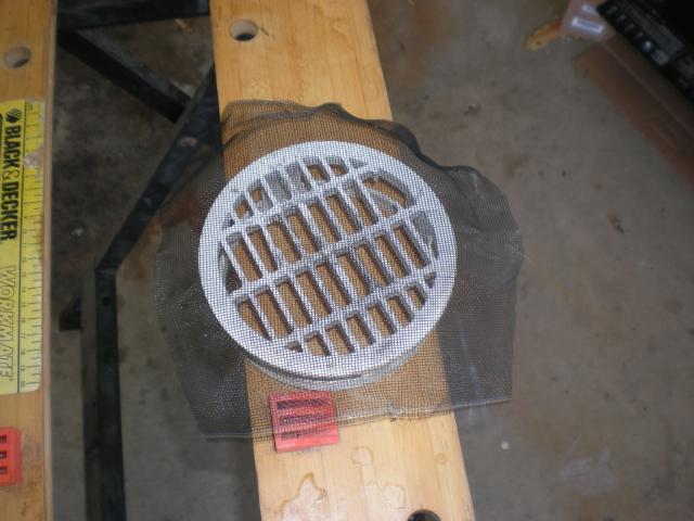 drain cover in garage with mesh