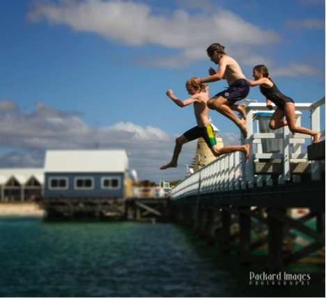 Busselton jetty sea leap