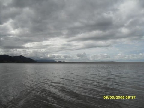 Leaving a Dull Cairns Harbour